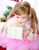 Happy little girl giving somebody a present. — Foto Stock