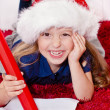 Happy little girl writing letter to Santa — Stock Photo #33148835