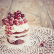 Vintage chocolate cupcake with sugared redcurrant — Stock Photo