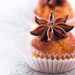 Cupcake decorated with cocoa and star anise — Stock Photo
