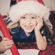 Happy little girl writing letter to Santa — Stock Photo