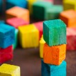 Colorful wooden building blocks — Stock Photo #44297363