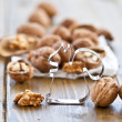 Walnut on a white paperbag — Stock Photo
