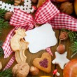 Text-free tin plate with christmas cookies and fruit — Stock Photo