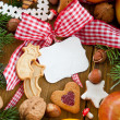 Text-free tin plate with christmas cookies and fruit — Stock Photo #26092447