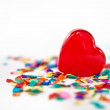 Stock Photo: Red hearts with confetti