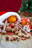 Christmas stocking filled with fruit and nuts — Stock Photo