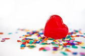 Red hearts with confetti — Stock Photo