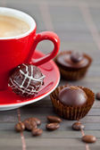 Espresso and chocolates — Stock Photo