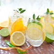 Fresh drink with lemons and ice — Stock Photo