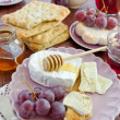Bread, cheese and grapes — Stock Photo