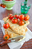 Flat bread with fresh tomatoes — Stock Photo