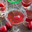 Cherry liquor in little glasses — Stock Photo