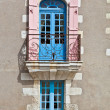 Oldfashioned window with balcony — Stock Photo