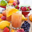 Juice from various fresh fruits — Stock Photo