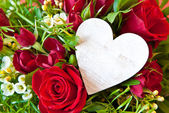 Red roses with a blank heart — Stock Photo