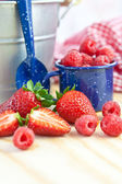 Fresh berries in little vintage cup — Stock Photo
