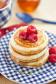 Pancakes with fresh red berries — Stock Photo