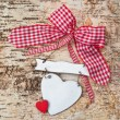 Blank heart on wooden background with red ribbon — Stock Photo