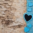 Wooden background with blue heart — Stock Photo
