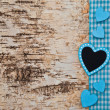 Stock Photo: Wooden background with blue heart