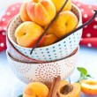 Fresh apricots in little cups — Stock Photo