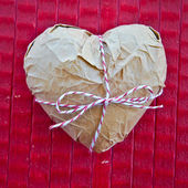 Heart wrapped in Paper — Stock Photo
