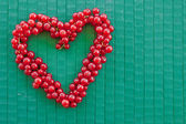 Red currant in heart-shape — Stock Photo