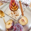 Rice pudding with cinnamon and plums — Stock Photo #30600155