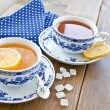 Various tea in china cups — Stock Photo