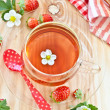 Fruity tea with strawberries — Stock Photo