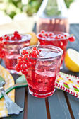 Fresh lemonade with red currant — Stock Photo