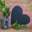 Stock Photo: Heart-shaped chalkboard with winter decorations