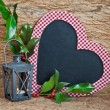 Heart-shaped chalkboard with winter decorations — Stock Photo