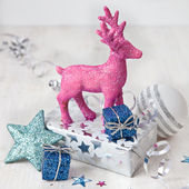 Pink deer and christmas decorations — Stock Photo