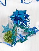 Little gift box and christmas decorations — Stock Photo