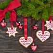 Pine tree branch with christmas cookies — Stock Photo