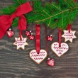 Pine tree branch with christmas cookies — Stockfoto