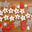 Merry Christmas written on cookies — Stock Photo
