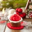 Little cupcake with Santa hat — Stock Photo