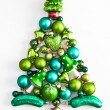 Green christmas ornaments in a tree shape — Stock Photo