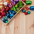 Little box with christmas baubles — Stock Photo #36514097