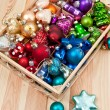 Little box with christmas baubles — Stock Photo