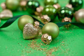 Christmas ornaments in various green tones — Stock Photo