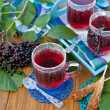 Stock Photo: Tea with fresh elder berries