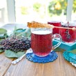 Tea with fresh elder berries — Stock Photo