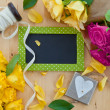 Stock Photo: Colorful roses and a little blackboard
