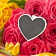 Stock Photo: Colorful roses and little blackboard