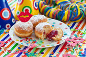 Fresh beignets on colorful plate — Stock Photo
