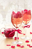 Cocktail with rose petals — Stock Photo